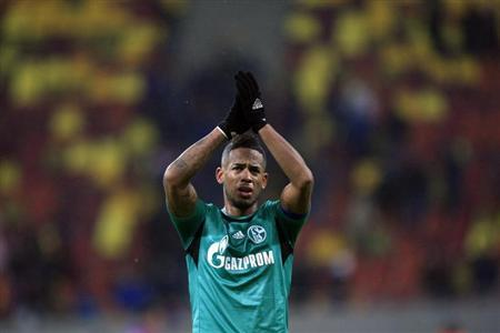 Schalke 04's Aogo acknowledges the crowd after their Champions League soccer match against Steaua Bucharest in Bucharest