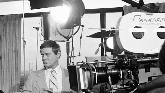 "FILE - This Feb. 2, 1979 file photo shows actor Larry Hagman next to a camera on the set of the television series ""Dallas.""  Actor Larry Hagman, who for more than a decade played villainous patriarch JR Ewing in the TV soap Dallas, has died at the age of 81, his family said Saturday Nov. 24, 2012.  (AP Photo/George Brich, File)"