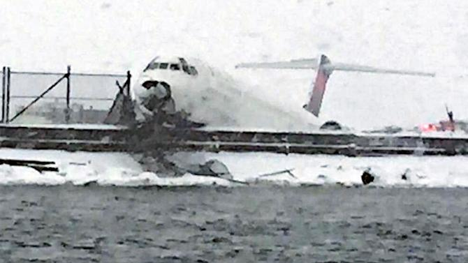 This image provided by @NYPDSpecialops shows Delta flight 1086 from Atlanta after it skidded off the runway on March 5, 2015 at La Guardia Airport in New York, during a heavy snow storm