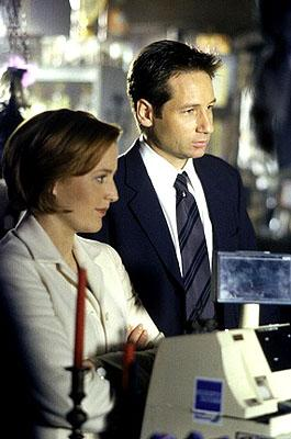 """Agents Scully (Gillian Anderson, L) and Mulder (David Duchovny, R) investigate a series of bizarre and connected murders with characteristics  pointing to the occult in the """"Theef"""" episode of Fox's The X-Files X-Files"""