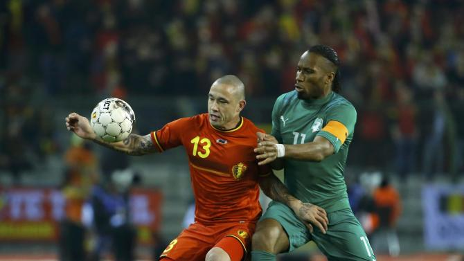 Belgium's Nainggolan and Ivory Coast's Drogba battle for the ball during their international friendly soccer match at King Baudouin Stadium in Brussels