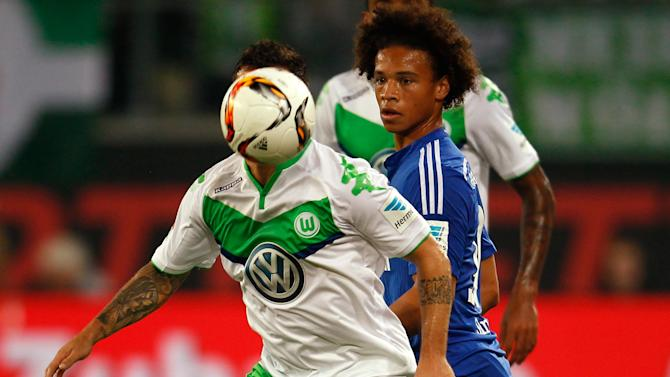 Wolfsburg's Vieirinha is challenged by Schalke 04's Sane during their Bundesliga first division soccer match in Wolfsburg