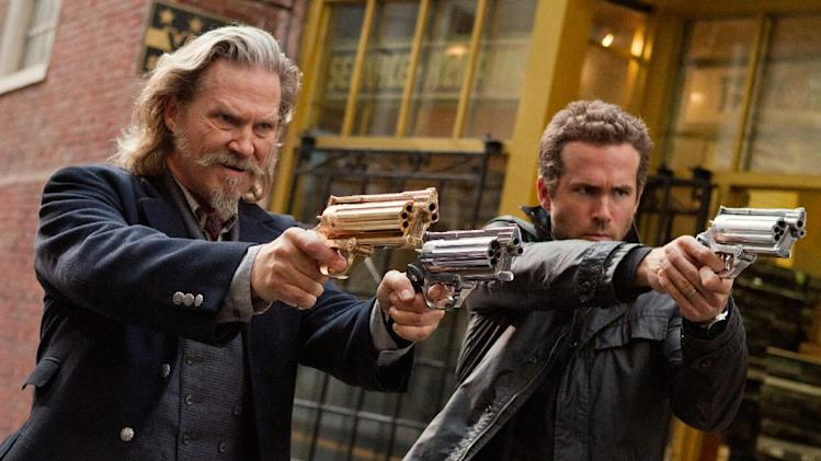 "This film publicity image released by Universal Pictures shows Jeff Bridges, left, and Ryan Reynolds in a scene from ""R.I.P.D."" (AP Photo/Universal Pictures, Scott Garfield, File)"