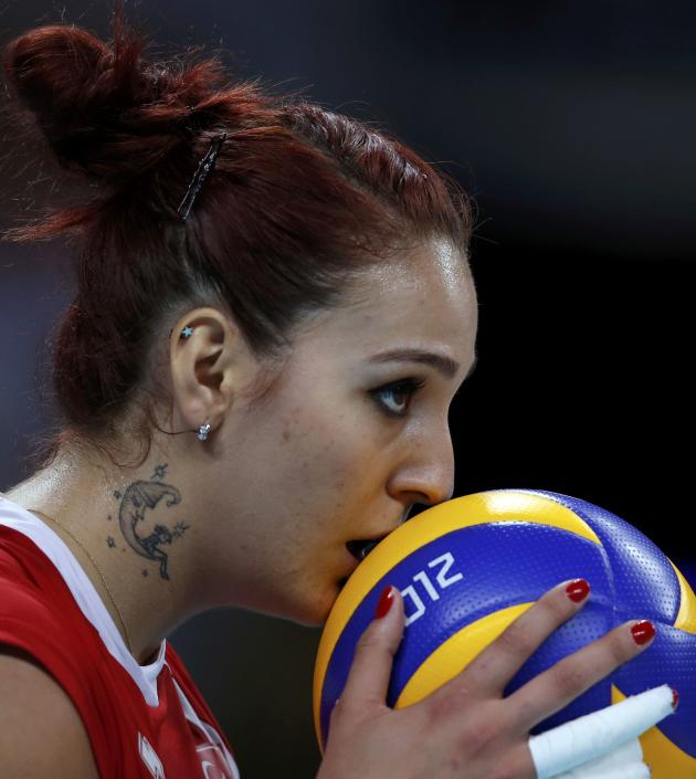 Turkey's Bahar Toksoy kisses the ball as she prepares to serve against South Korea during their women's Group B volleyball match at Earls Court during the London 2012 Olympic Games
