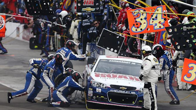 Dale Earnhart Jr., makes a pit stop during the NASCAR Sprint Cup Series auto race, Sunday, March 3, 2013, in Avondale, Ariz. (AP Photo/Matt York)