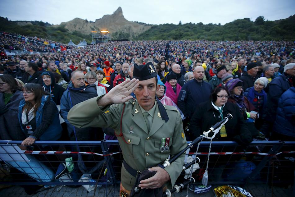A bagpiper from the Australian army salutes during a dawn ceremony marking the 100th anniversary of the Battle of Gallipoli, at Anzac Cove in Gallipoli