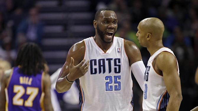 Charlotte Bobcats' Al Jefferson (25) talks with teammate Gerald Henderson (9) during the first half of an NBA basketball game against the Los Angles Lakers in Charlotte, N.C., Saturday, Dec. 14, 2013