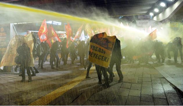 Riot police use water cannon to disperse demonstrators during a protest in Ankara