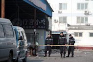 Chinese police in Sanhe, Hebei province, on January 7, 2009. A man in northern China has driven a car carrying a gas canister and firecrackers into a crowd of schoolchildren, injuring 13, state media reported Tuesday