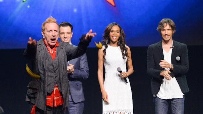 "From left, singer John Rotten Lydon throws bananas at the media, JC Chasez, Michelle Williams and Brandon Boyd look on, at the ""Jesus Christ Superstar"" arena spectacular press conference and press performance to announce a North American arena tour on Friday, April 4, 2014, in New York. (Photo by Evan Agostini/Invision/AP)"