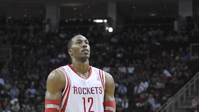 Houston Rockets' Dwight Howard stands at the foul line in the second half of an NBA basketball game against the Denver Nuggets, Saturday, Nov. 16, 2013, in Houston. Howard was deliberately fouled multiple times in the fourth quarter of the Rockets 122-111 win