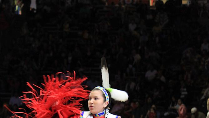 An unidentified dancer competes at the 30th annual Gathering of Nations in Albuquerque, N.M., on Friday, April 26, 2013. The powwow draws hundreds of competitive dancers and tens of thousands of spectators each year. (AP Photo/Susan Montoya Bryan)