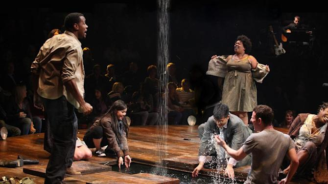 "In this theater image released by The Publicity Office, Wallace Smith, standing left, and Celisse Henderson, standing right, are shown with the company in a scene from ""Godspell,"" in New York. Producers said Wednesday, June 13, 2012, that the hip retelling of the New Testament's Gospel of Matthew will close June 24 at the Circle in the Square Theatre.  (AP Photo/The Publicity Office, Jeremy Daniel)"