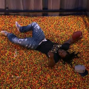 Marshawn Lynch Makes Sweet End Zone Dive Into Pool of Skittles