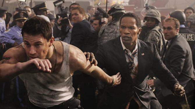 "This film publicity image released by Columbia Pictures shows Jamie Foxx and Channing Tatum, left, in a scene from ""White House Down."" (AP Photo/Sony Columbia Pictures, Reiner Bajo)"