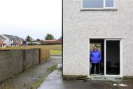 Rhoda Brogan poses for a photograph in the show home which neighbours her own home, on the Glenall housing estate in the village of Borris-in-Ossory, County Laois, Ireland February 13, 2013. REUTERS/Cathal McNaughton