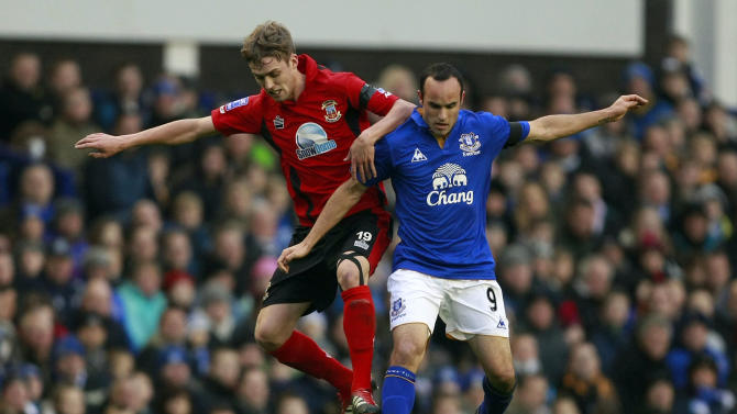 Everton's Landon Donovan, right, vies for the ball against Tamworth's Scott Barrow during their English FA Cup third round soccer match at Anfield, Liverpool, England, Saturday Jan. 7, 2012. (AP Photo/Tim Hales)