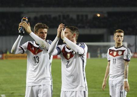 Germany's Mueller Schweinsteiger and Reus applaud supporters after winning their Euro 2016 qualifier soccer match against Georgia in Tbilisi