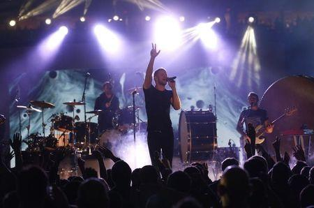 Imagine Dragons perform during the half-time show at the CFL's 102nd Grey Cup football championship between the Calgary Stampeders and the Hamilton Tiger Cats in Vancouver