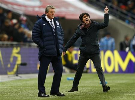 Germany's coach Loew celebrates nex to England's manager Hodgson after their international friendly soccer match at Wembley Stadium in London