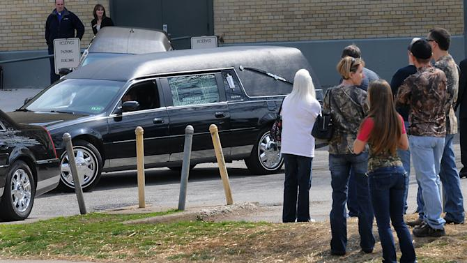 "A hearse leaves the Municipal Auditorium in Charleston, W.Va. after a joint funeral for ""Buckwild"" star Shain Gandee and his uncle David Gandee Sunday afternoon, April 7, 2013. Gandee, his 48-year-old uncle, David Gandee, and 27-year-old friend Donald Robert Myers were found dead April 1 in a sport utility vehicle that was partially submerged in a deep mud pit near Sissonville. (AP Photo/The Charleston Gazette, Kenny Kemp)"