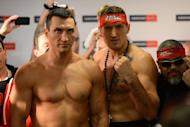 Ukrainian heavyweight boxing world champion Wladimir Klitschko (L) and challenger Polish Mariusz Wach pose during the official weigh-in, on November 9, in the nothern German city of Hamburg, on the eve of their fight