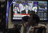 House Speaker John Boehner, R-Ohio, is seen on a television screen on the floor of the New York Stock Exchange Monday, Aug. 1, 2011. (AP Photo/Richard Drew)