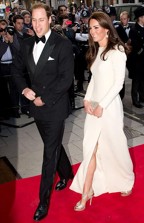 The 30-year-old Duchess wows with a high slit in an otherwise modest gown and sequined silver heels. Prince William accompanied his wife to a private dinner on May 7 hosted by the Thirty Club at Clari
