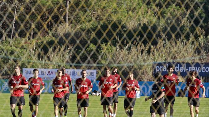 Portugal's soccer players run during their training session in Obidos