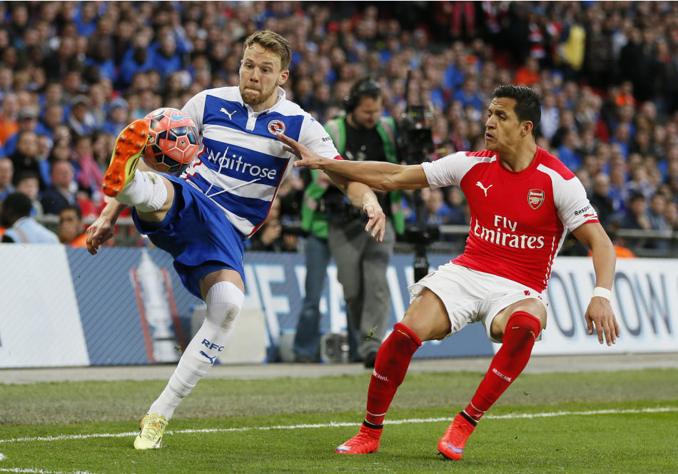 Football: Reading's Chris Gunter in action with Arsenal's Alexis Sanchez