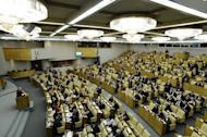 File picture shows legislators debating a bill banning Americans from adopting Russian children in the lower house of Russia's parliament, the State Duma, in Moscow, on December 21, 2012. Russian lawmakers on Tuesday backed a bill which would place tough restrictions on adoption to countries where same-sex marriages are legal, following France's vote last month allowing such unions