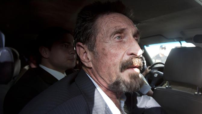 Software company founder John McAfee leaves an immigration detention center for the La Aurora international airport in Guatemala City, Wednesday Dec. 12, 2012. McAfee, who is being deported to the U.S., was detained last week for immigration violations after he sneaked into Guatemala from neighboring Belize, where authorities sought to question him about the murder of his neighbor. (AP Photo/Moises Castillo)