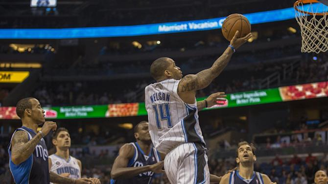 Orlando Magic's Jameer Nelson (14) lays the ball up against the Dallas Mavericks' during the first half of an NBA basketball game in Orlando, Fla., Saturday, Nov. 16, 2013