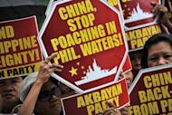 "Activists hold a protest in front of the Chinese Consular Office in Manila on April 16 demanding Beijing to immediately pull out from Scarborough Shoal. China has warned the Philippines not to ""internationalise"" the two countries' simmering territorial dispute in the South China Sea, as US and Philippine forces staged war games in the area"