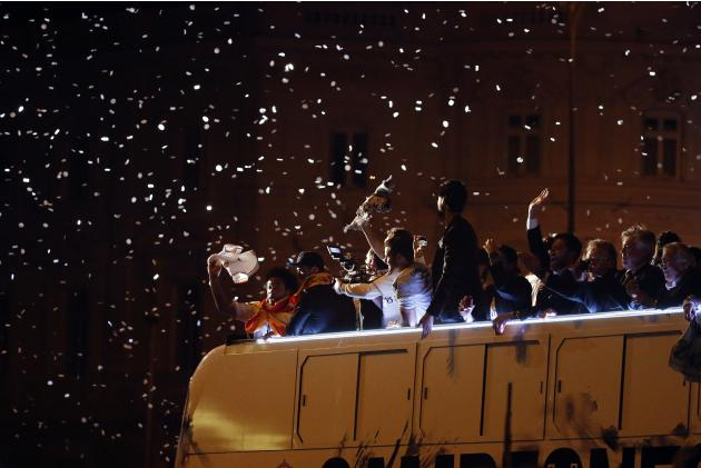 Real Madrid players celebrate winning the King's Cup on top of a bus as they arrive at Cibeles fountain in central Madrid