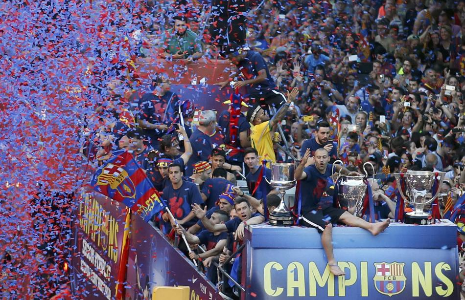 Barcelona's Mascherano and his team mates celebrate from an open-top bus during celebration parade in Barcelona