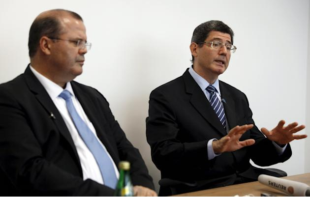 Brazil's Finance Minister Levy speaks next to Brazil's Central Bank President Tombini at a news conference at the 2015 IMF/World Bank Annual Meetings in Lima, Peru