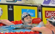 Ye Shiwen (C) of China celebrates her gold medal in the women 200m individual medley final during the FINA World Short Course Swimming Championships in Istanbul on December 15, 2012
