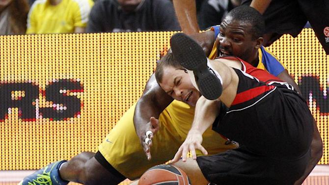 Sofoklis Schortsanitis, right, of  Israel's  BC Maccabi Electra Tel Aviv is challenged by Steponas Babrauskas , left, from  Lithuania's BC Lietuvos rytas during the Euroleague basketball  match  in Vilnius, Lithuania, Thursday, Nov. 7, 2013