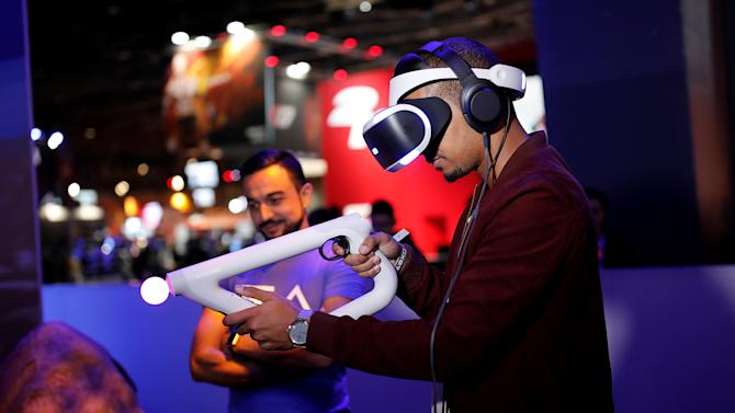A man plays Farpoint on a Sony PlayStation VR at the Paris Games Week, a trade fair for video games in Paris
