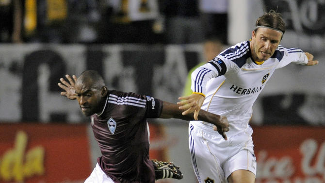 Colorado Rapids defender Marvell Wynne, left, and Los Angeles Galaxy midfielder David Beckham battle for the ball during the second half of their MLS soccer match, Friday, Sept. 9, 2011, in Carson, Calif. The Galaxy won 1-0. (AP Photo/Mark J. Terrill)