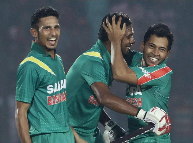 Bangladesh's captain Mushfiqur Rahim congratulates Nasir Hossain and Sohag Gazi after Bangladesh whitewashed New Zealand in their One-day International (ODI) cricket series in Narayanganj.