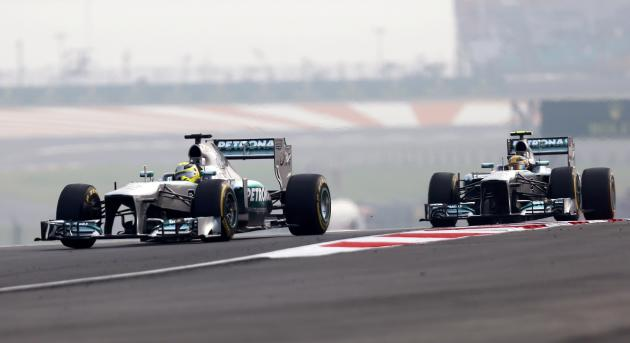 Mercedes Formula One driver Rosberg and Mercedes Formula One driver Hamilton drive during the qualifying session of the Indian F1 Grand Prix at the Buddh International Circuit in Greater Noida