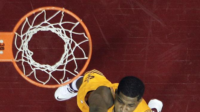 Miami Heat's LeBron James, bottom, shoots over Cleveland Cavaliers' Tristan Thompson in the second half of an NBA basketball game Wednesday, Nov. 27, 2013, in Cleveland. James scored 28 points in a 95-84 win over the Cavaliers
