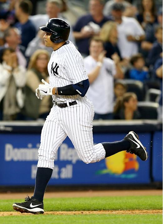 Alex Rodriguez of the New York Yankees heads for home after hitting a grand slam in the seventh inning against the San Francisco Giants on September 20, 2013 at Yankee Stadium