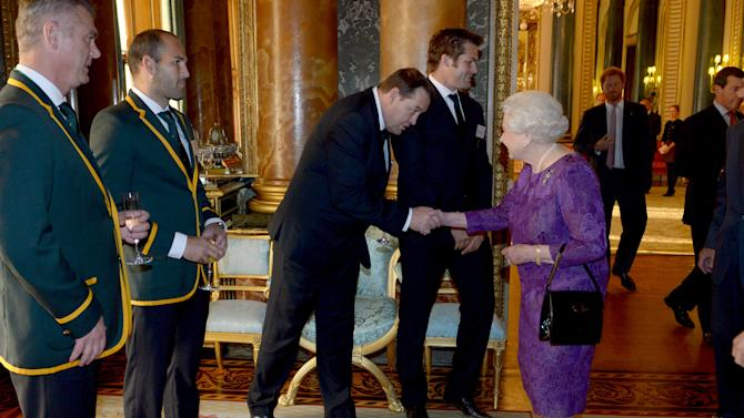 Britain's Queen Elizabeth meets New Zealand's Rugby Union head coach Steve Hansen at a reception at Buckingham Palace to welcome Rugby World Cup participants