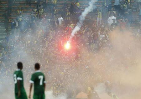 Players from Saudi Arabia watch as a flare is thrown during their 2018 World Cup qualifying soccer match against Malaysia in Kuala Lumpur, Malaysia