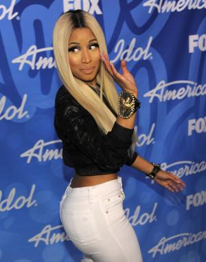 """FILE - This May 16, 2013 file photo shows singer and judge Nicki Minaj backstage at the """"American Idol"""" finale in Los Angeles. Minaj is following Mariah Carey out of the door on """"American Idol."""" The hip-hop diva announced Thursday on Twitter that it was """"time to focus on the music."""" (Photo by Chris Pizzello/Invision/AP, file)"""