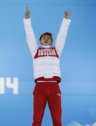 Viktor Ahn of Russia, who won the bronze medal in the men's 1,500-meter short track speedskating celebrates during the medals ceremony at the 2014 Winter Olympics, Monday, Feb. 10, 2014, in Sochi, Russia. (AP Photo/Morry Gash)