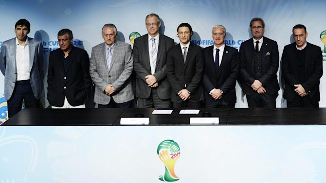 Soccer head coaches Victor Piturca , Romania, Fernando Santos, Greece, Oleg Formenko, Ukraine, Lars Lagerbaeck, Iceland , Niko Kovac, Croatia, Didier Deschamps, France, Erik Hamren , Sweden, and Paulo Bento, Portugal, from left, pose for photographers after the draw for the 2014 FIFA World Cup European zone play-off  soccer matches on Monday, Oct. 21, 2013, at the FIFA headquarters in Zurich, Switzerland